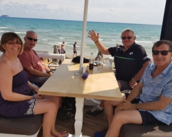 Guests enjoying lunch on the beach